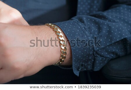 young man with a chain Stock photo © stepstock