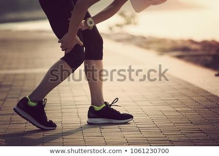 Térd sérülés sportsérülés támogatás nő egészség Stock fotó © BVDC