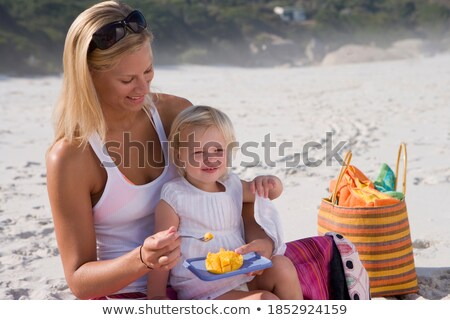 Woman in Swimwear at the Beach Carrying her Bag Stock photo © belahoche