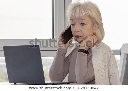 Sad woman calling someone with her mobile phone Stock photo © wavebreak_media