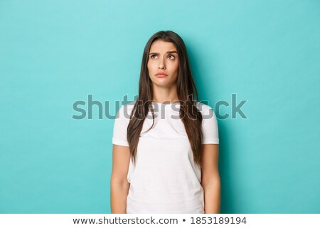 Portrait of amusing confused young woman with long hair  Stock photo © deandrobot
