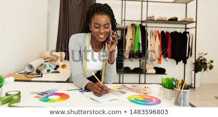 Cheerful tailor talking by phone Stock photo © dash