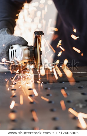 Angular grinding machine is cutting the metal Stock photo © vlad_star