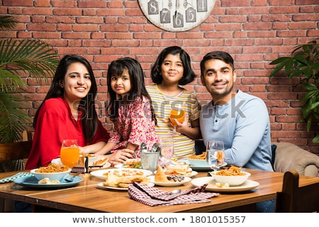 Mother and daughter eating breakfast Stock photo © IS2