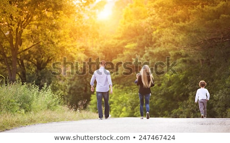 Father and son walking down a road Stock photo © IS2