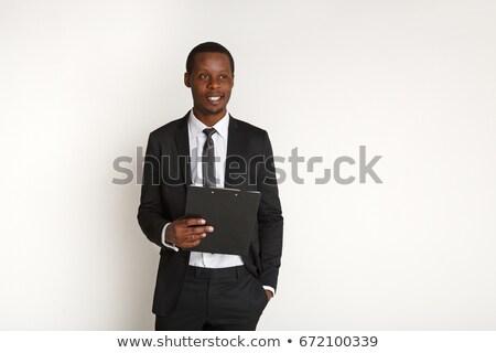 Afrikai üzletember áll iratok kéz vállalati Stock fotó © studioworkstock