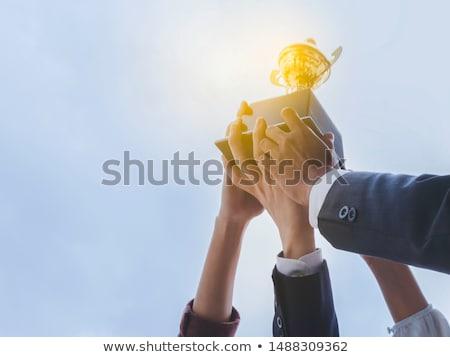 Empresario tomados de las manos hasta gráfico brazo dedo Foto stock © nezezon