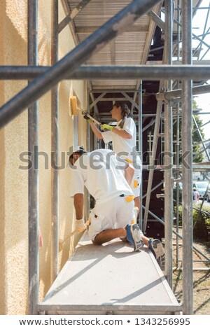 Iki çalışma ev duvar boya boyama Stok fotoğraf © Kzenon