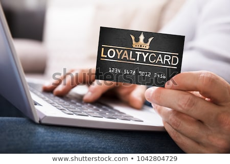 Close-up Of A Man Holding Loyalty Card Stock photo © AndreyPopov