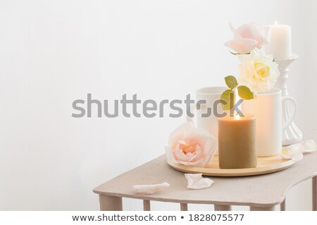 two burning candles with fresh roses stock photo © neirfy