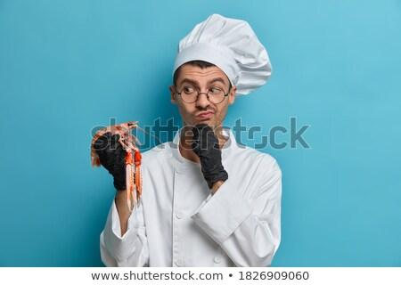 Nachdenklich Küchenchef Koch tragen einheitliche stehen Stock foto © deandrobot