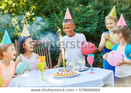 happy kids on birthday party at summer garden Stock photo © dolgachov