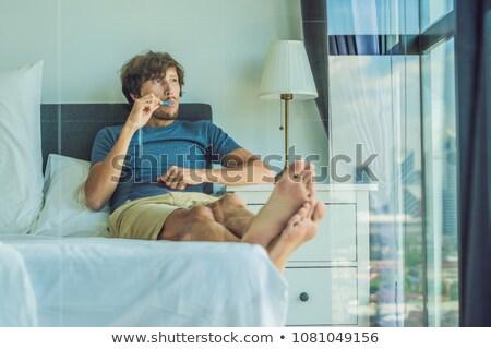 homem · fio · dental · limpeza · dentes · banheiro - foto stock © galitskaya