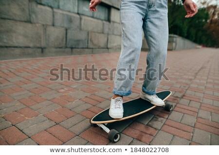 Stylish young woman standing on cobblestone Stock photo © Kzenon