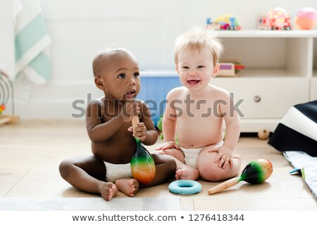 A six month old baby, sit on the floor Stock photo © Lopolo