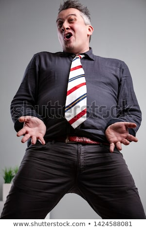Low angle from the knees up of a man singing Stock photo © Giulio_Fornasar