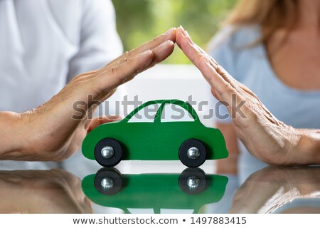Couple Protecting Green Wooden Car Stock photo © AndreyPopov
