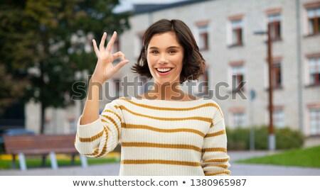 Genç kız neden el işareti kampus eğitim Stok fotoğraf © dolgachov