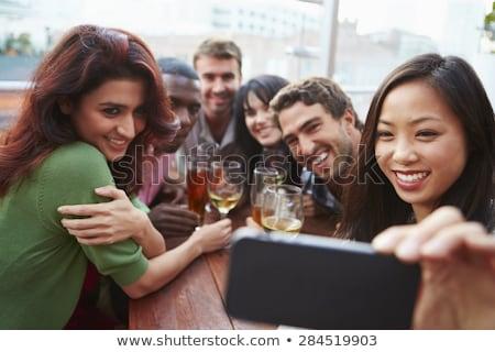 women taking selfie by smartphone at wine bar stock photo © dolgachov