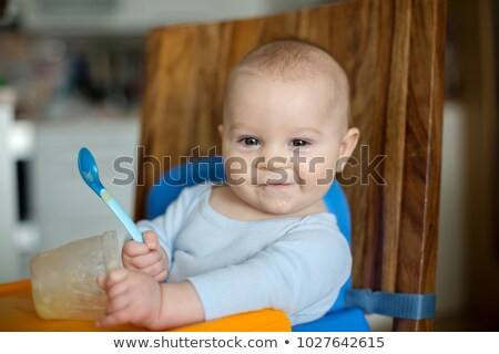 a little child eating a pumpkin and his parents stock photo © photography33