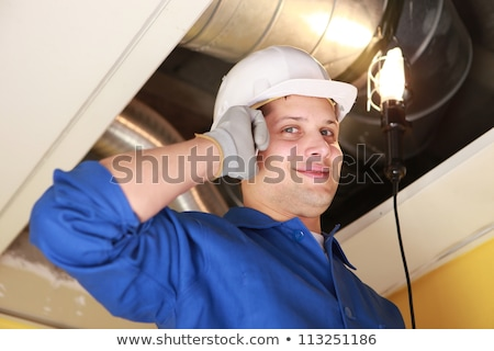 Manual worker inspecting air-conditioning system Stock photo © photography33