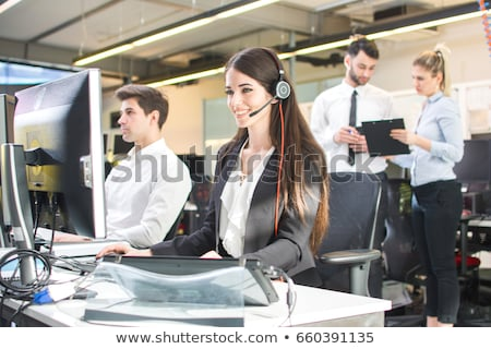 Female call-center agent with clipboard Stock photo © photography33