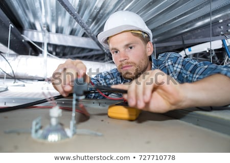 Stock photo: Two electrician working on ceiling wiring