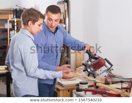 Carpenter measuring wood lath Stock photo © photography33