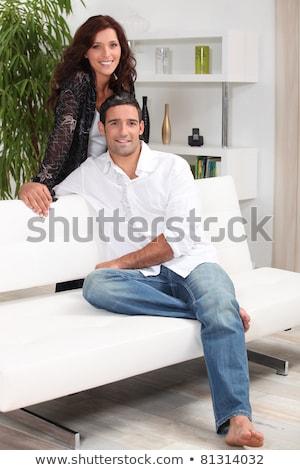 Brunette sat on designer sofa Stock photo © photography33