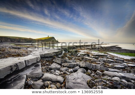 Laag getij kustlijn strand hemel zee Stockfoto © flotsom
