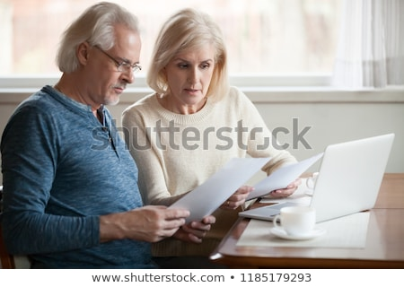 senior couple at home with bills worried about home finances stock photo © highwaystarz