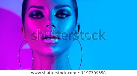 Beautiful woman with purple makeup Stock photo © phakimata
