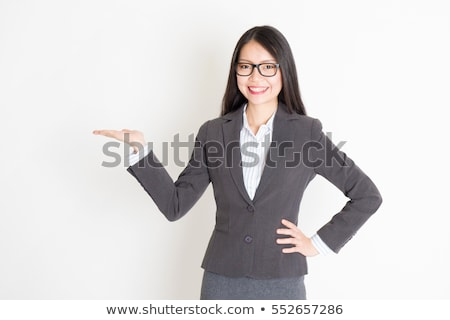 Businesswoman holding hands out in presentation Stock photo © wavebreak_media