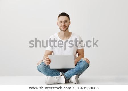 Férfi modell ül lábak keresztbe mosolyog fából készült láda Stock fotó © juniart