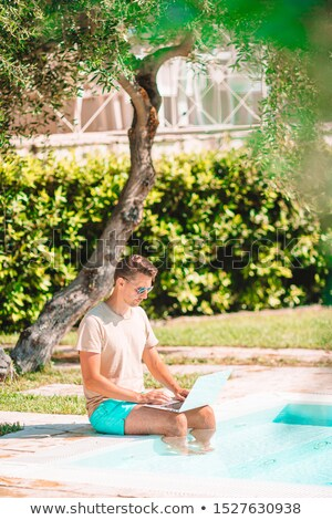young man with a tablet with the text vacation Stock photo © nito