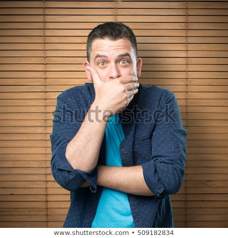 face of man covering his mouth with hand palm stock photo © dolgachov