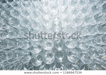Rows of shiny empty high glasses stock photo © dariazu