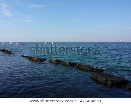 A few small ships in the sea near coast Stock photo © Vanzyst