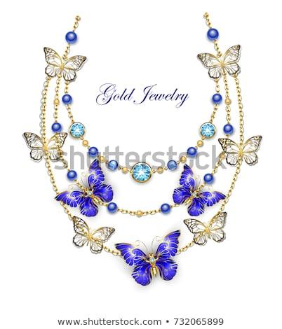 Colier safir fluturi aur lanţuri albastru Imagine de stoc © blackmoon979