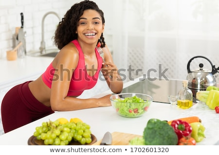 Girl leaning on dinner table Stock photo © IS2