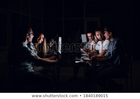 colleagues discussing project at nigh office Stock photo © dolgachov