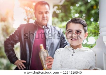 Félő félvér fiú mérges férfi tart Stock fotó © feverpitch