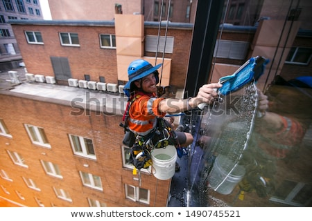 Window cleaner with safety equipments Stock photo © colematt