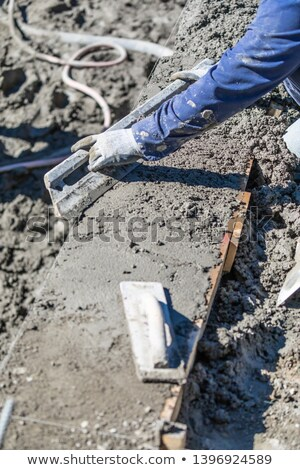 Piscine travailleur de la construction travail tige humide concrètes Photo stock © feverpitch