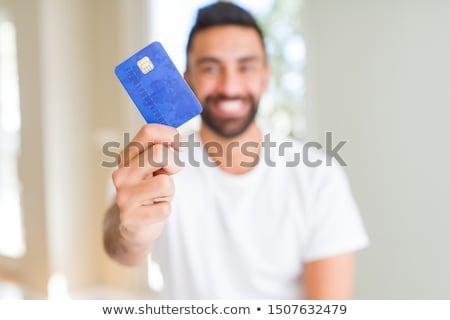 alegre · homem · cartão · de · crédito · tiro - foto stock © szefei