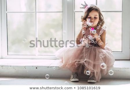 Zoete meisje vergadering studio witte hand Stockfoto © Lopolo