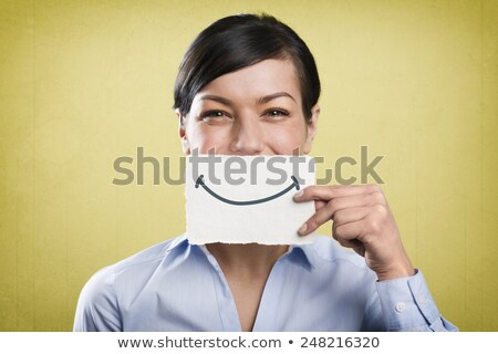 laughing businesswoman holding empty white card in front of her stock photo © lichtmeister