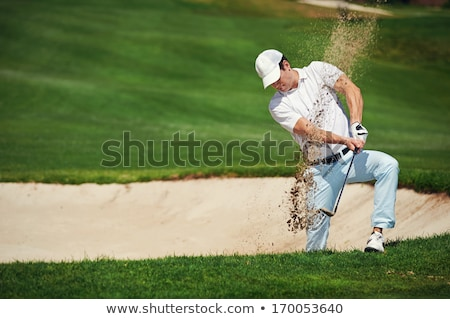 Male golf player pitching on course. Stock photo © lichtmeister
