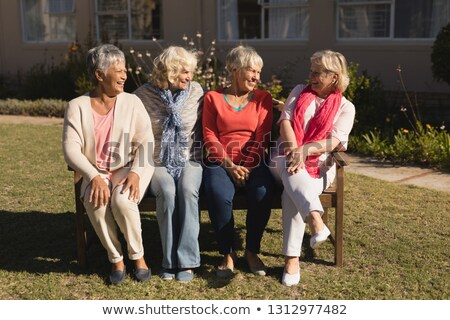Front view of senior friends interacting with each other at nursing home Stock photo © wavebreak_media