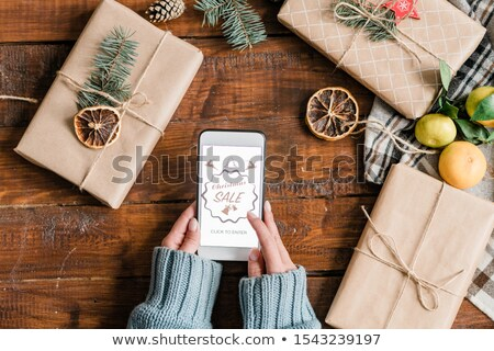 Hands of young female shopper going to enter online shop to order xmas gifts Stock photo © pressmaster